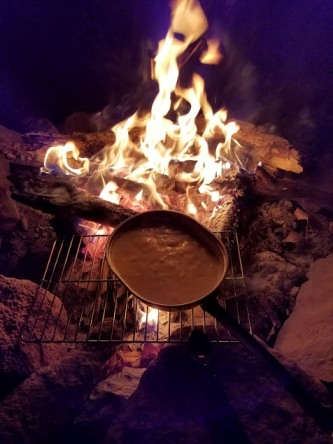 Clam chowder over an open fire - primitive camping.